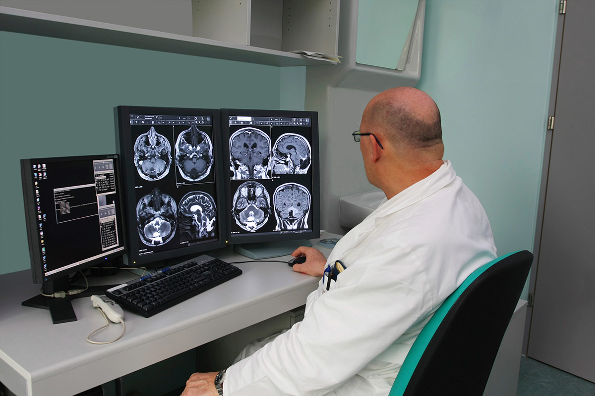 Doctor viewing scans